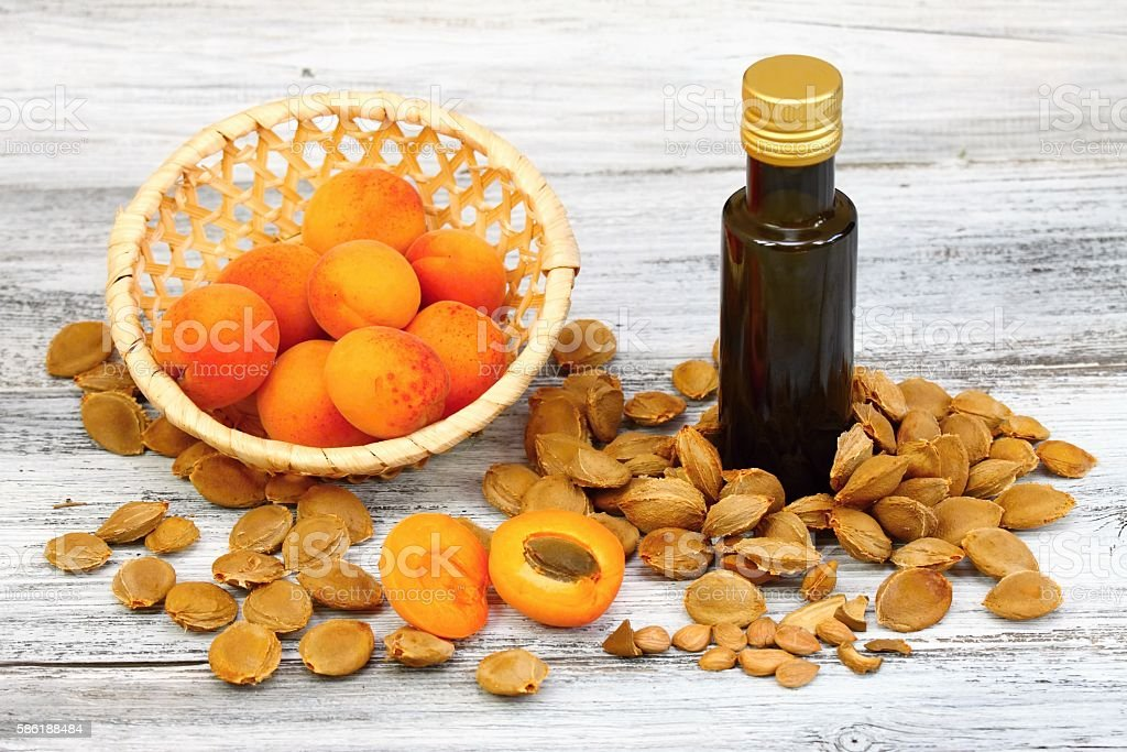 Apricot oil from  apricot kernels in a brown bottle stock photo