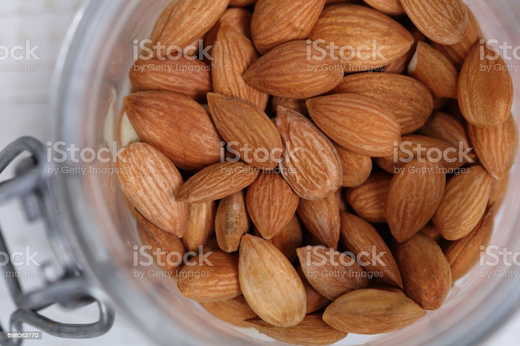 Apricot Seeds in a bowl. Vitamin b 17. Healthy eating, Cancer prevention concept, alternative medicine. stock photo