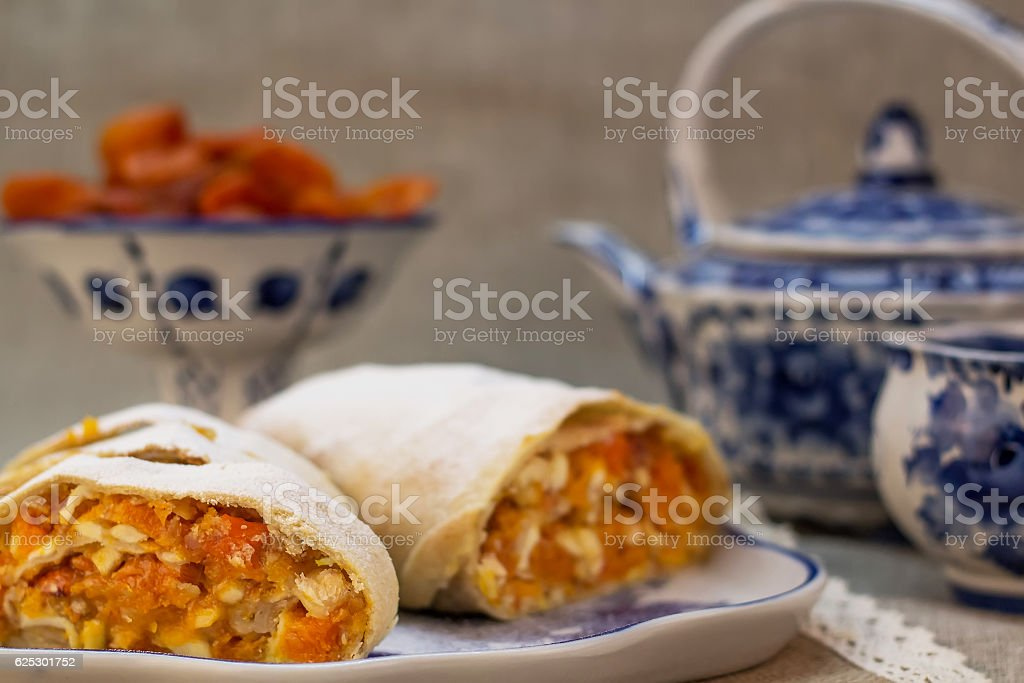 apricot strudel sprinkled with powdered sugar stock photo