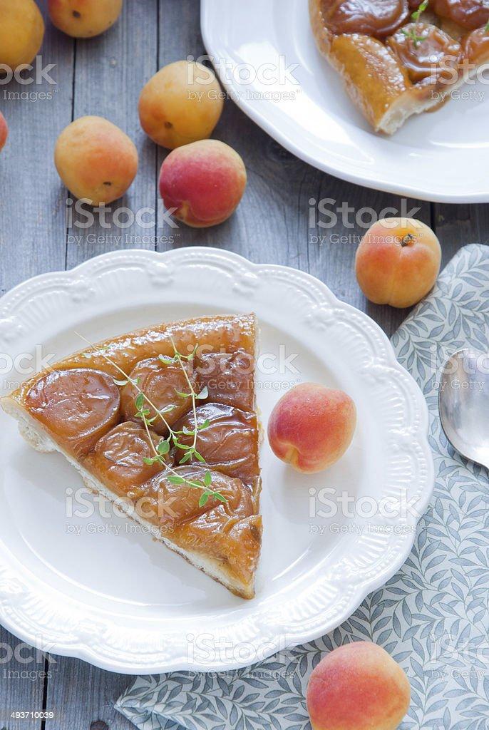 Apricot tarte Tatin with thyme stock photo