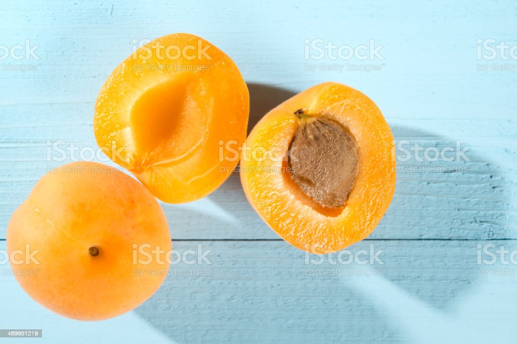 Apricots on a blue table stock photo