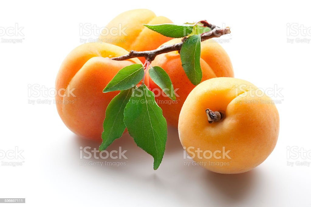 Apricots with leaves isolated on white stock photo