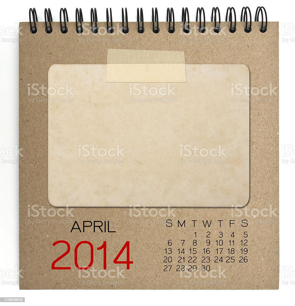 April 2014 Calendar brown notebook with old blank photo royalty-free stock photo