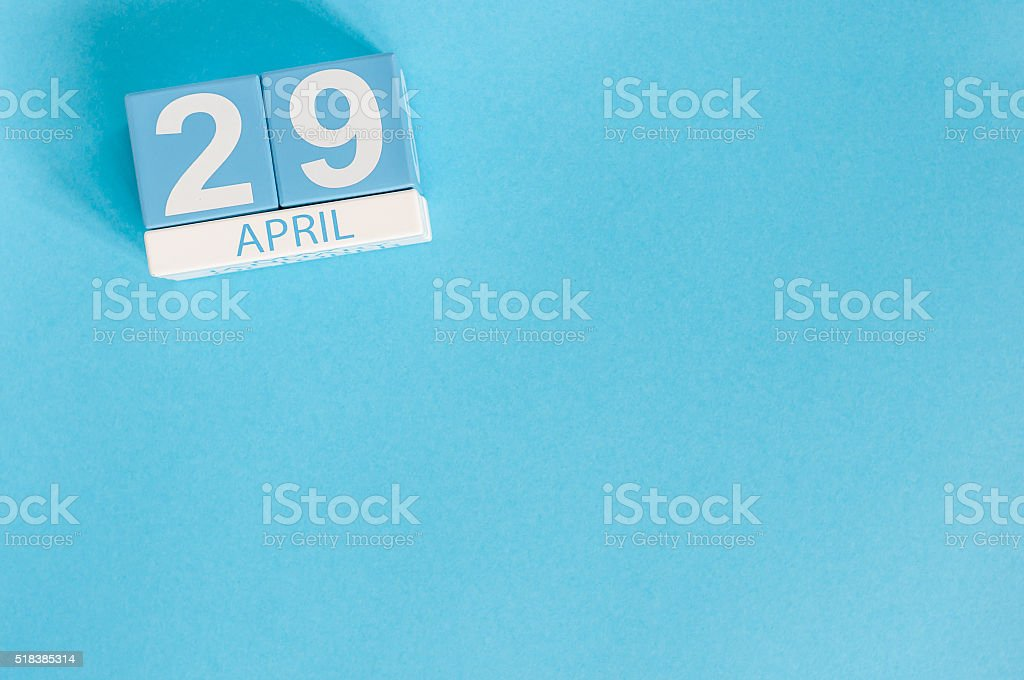 April 29th. Image of april 29 wooden color calendar on stock photo
