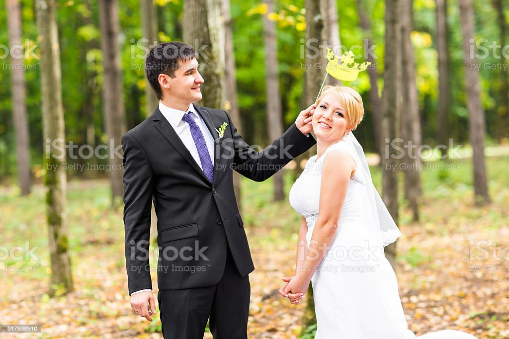 April Fools' Day. Wedding couple posing with stick lips, mask stock photo