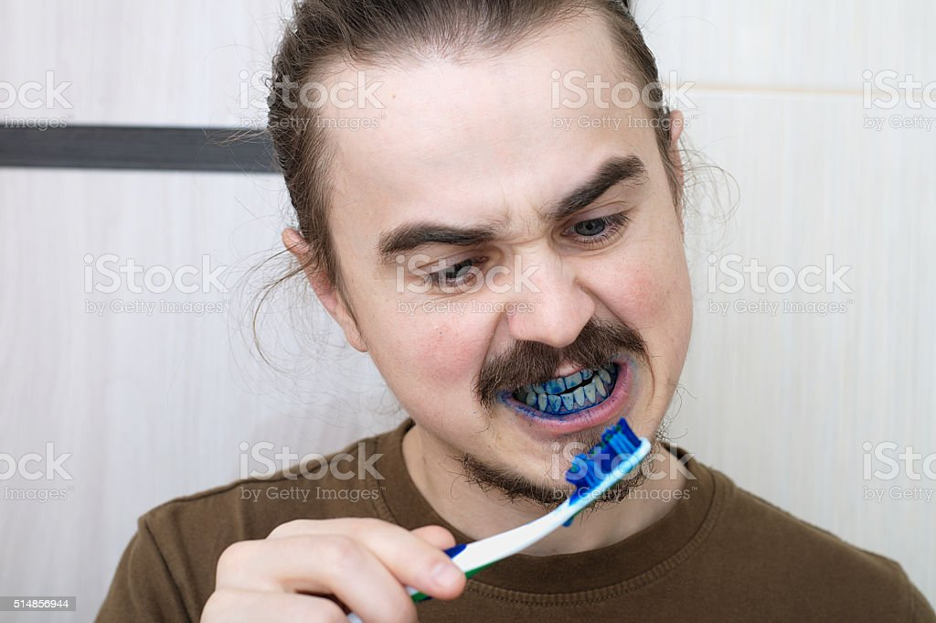 April joke by colouring tooth brush stock photo