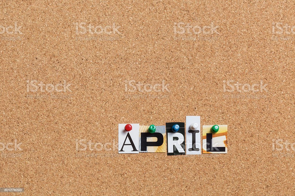 April pinned on bulletin cork board royalty-free stock photo