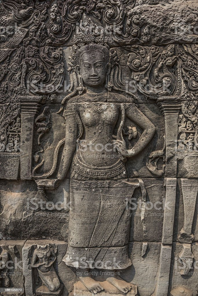 Apsara carved on the wall of Elephant terrace, Angkor Thom. stock photo