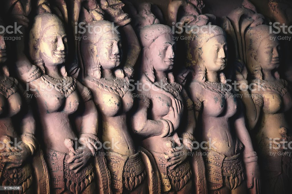 Apsara Dancers carved on walls royalty-free stock photo