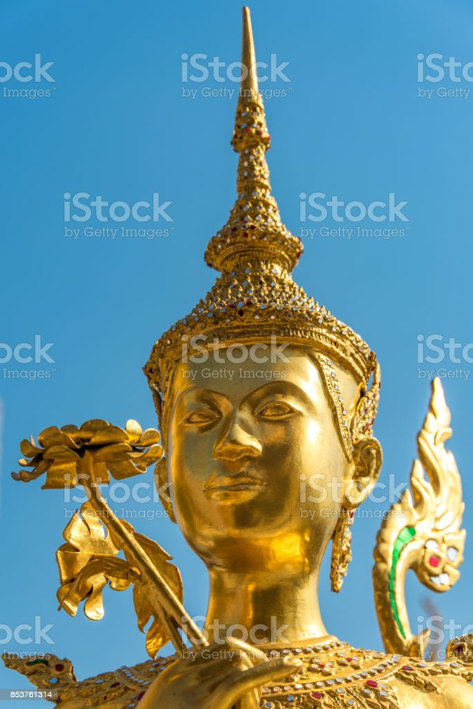 Apsonsi Gold statue. Asian art close up stock photo