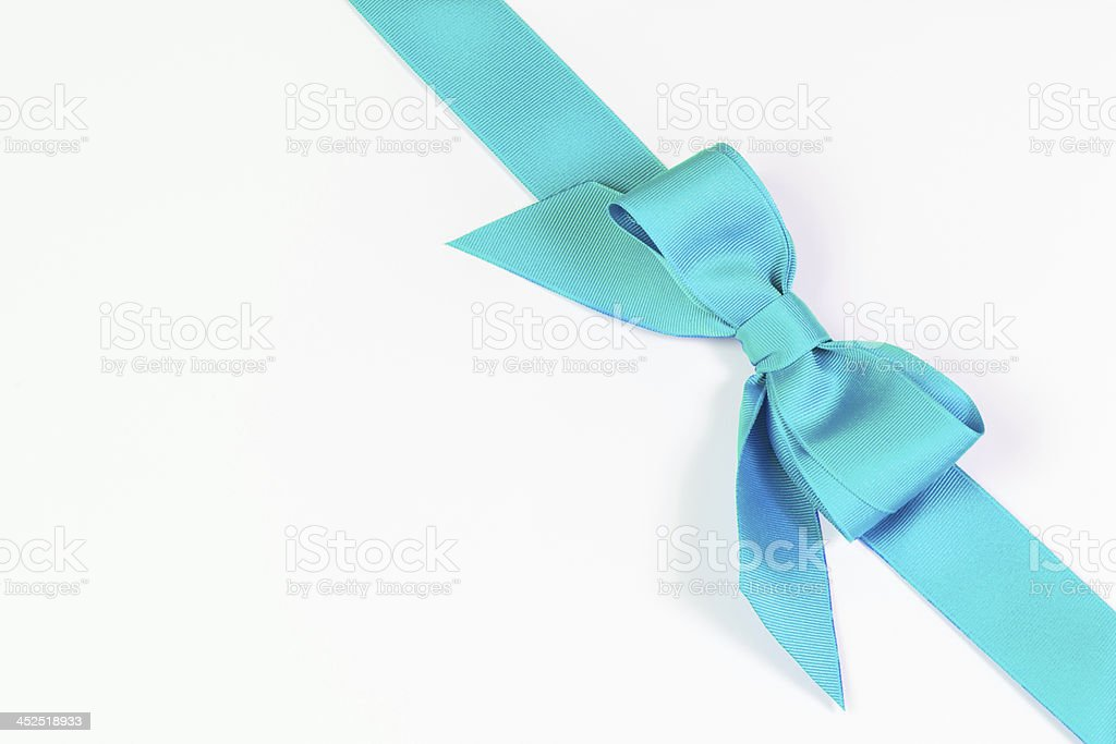 Aqua blue ribbon and bow on white stock photo