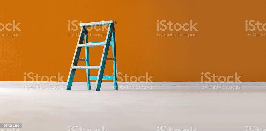 Aqua wooden ladder on yellow background stock photo