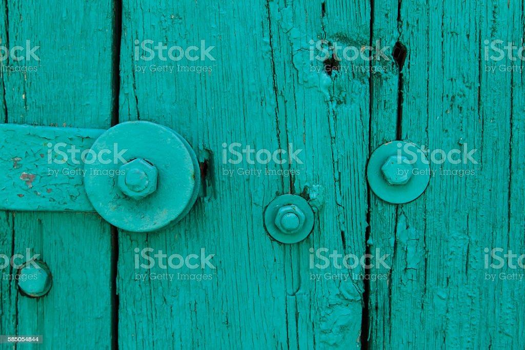 Aquamarin Door,Crack Paint,Big Steel Bolt,Screw,Nuts,Texture stock photo
