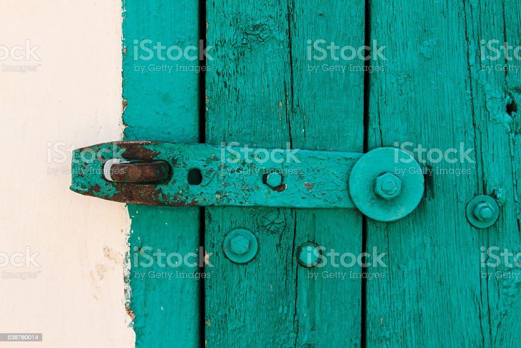 Aquamarin Old Vintage Door,Crack Paint Steel Bolt,Texture stock photo