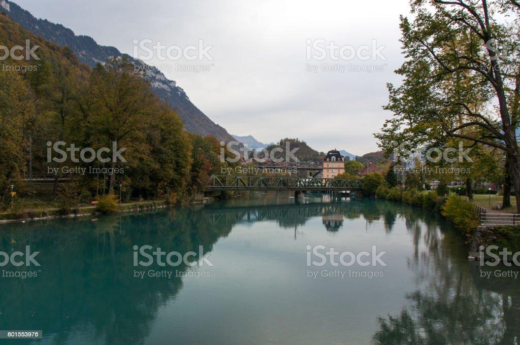 Aquamarine lake in alpine town stock photo