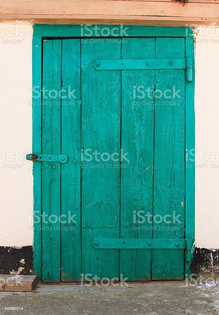 Aquamarine Old Door,Crack Paint,Steel Bolt stock photo