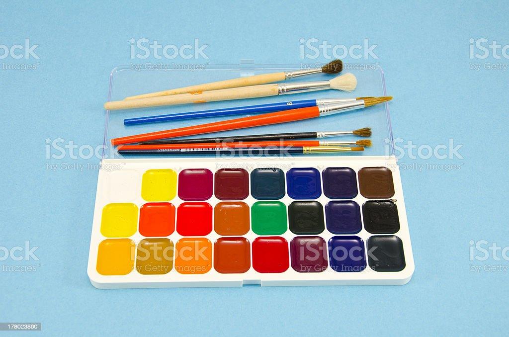 aquarelle art tools on azure background stock photo