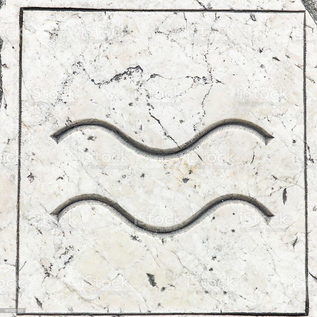 Aquarius symbol engraved in marble stock photo