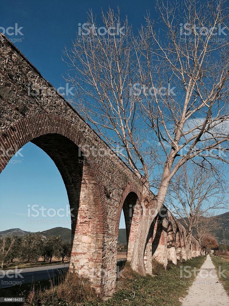 Aqueduct in Asciano Pisano - Tuscan landmark stock photo