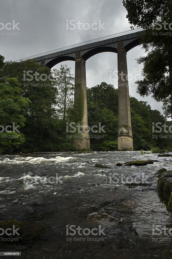 Aqueduct over river stock photo