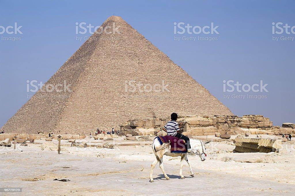 Arab boy and pyramid stock photo
