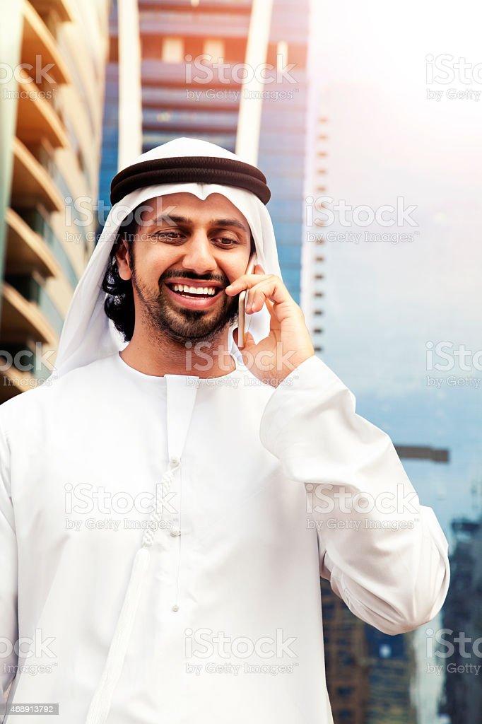 Arab business on the phone in Dubai. stock photo