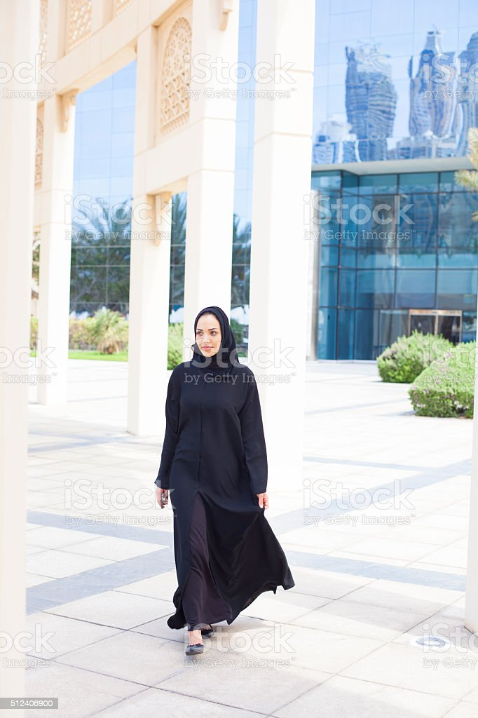 Arab business woman in front of traditional architectural detail stock photo
