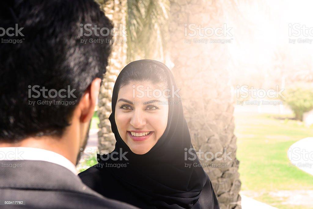 Arab businessman and woman having conversation stock photo