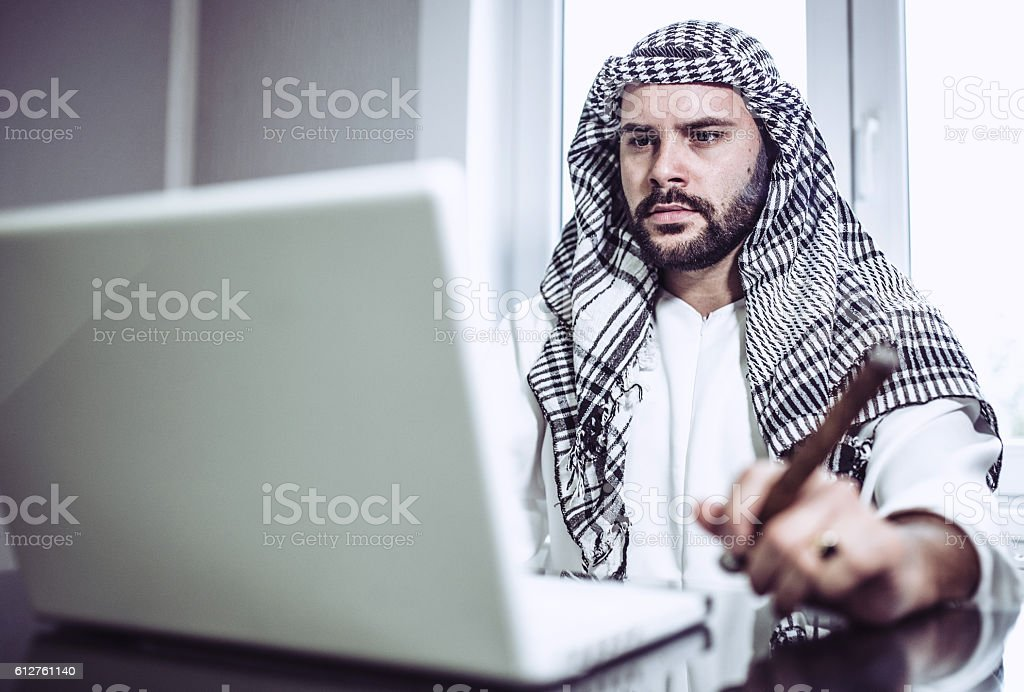 Arab businessman in office working stock photo