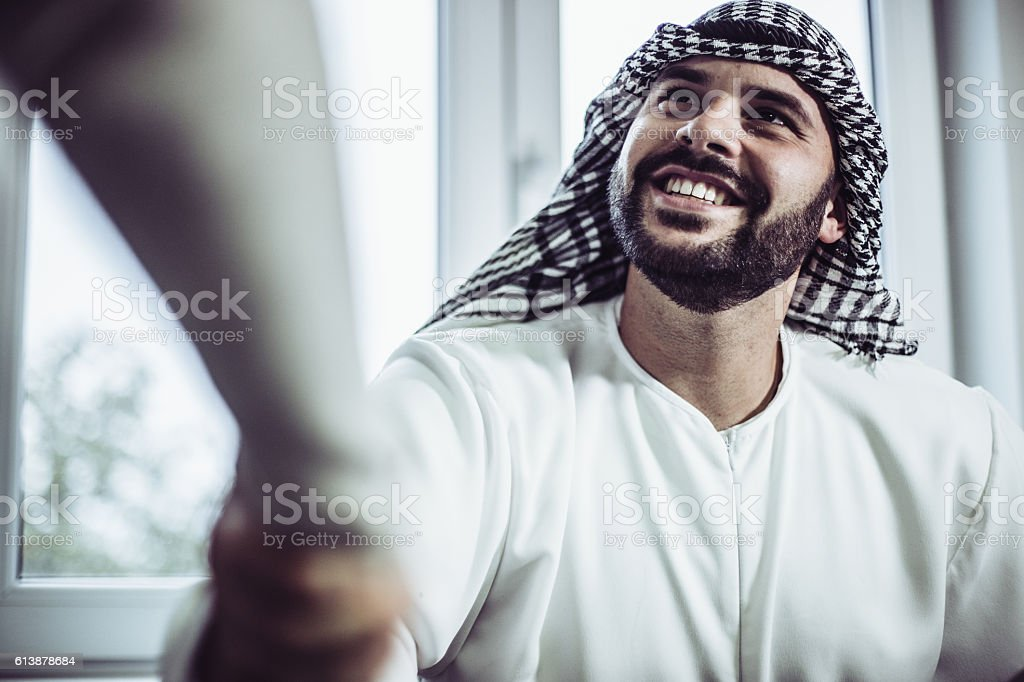 Arab businessman making a deal stock photo