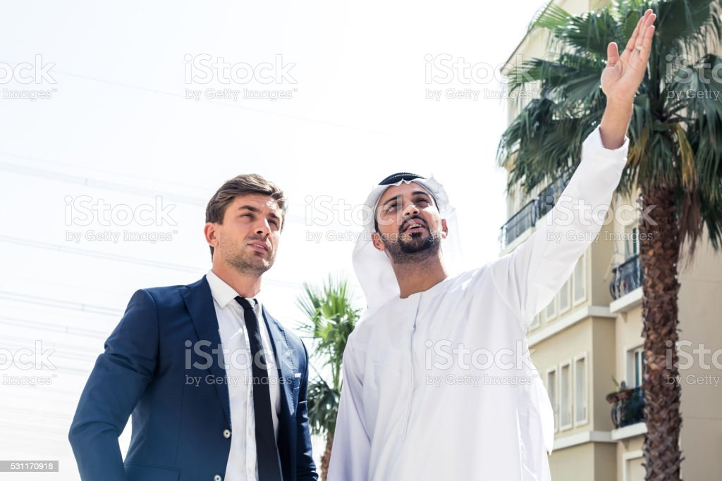 Arab Businessman Showing his Project stock photo