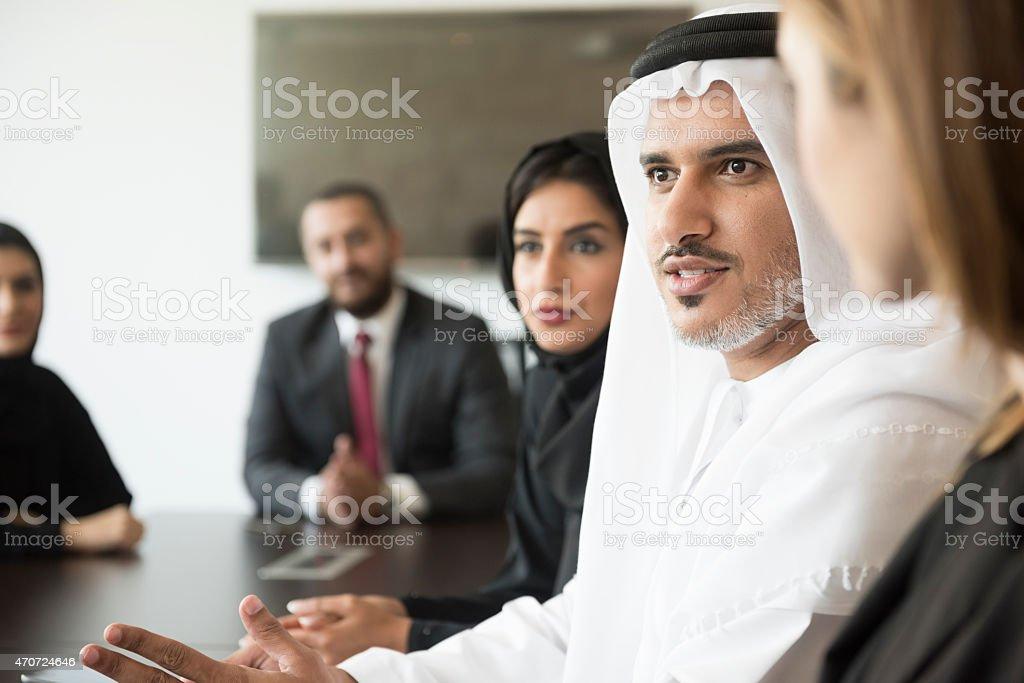 Arab businessman talking in a meeting stock photo