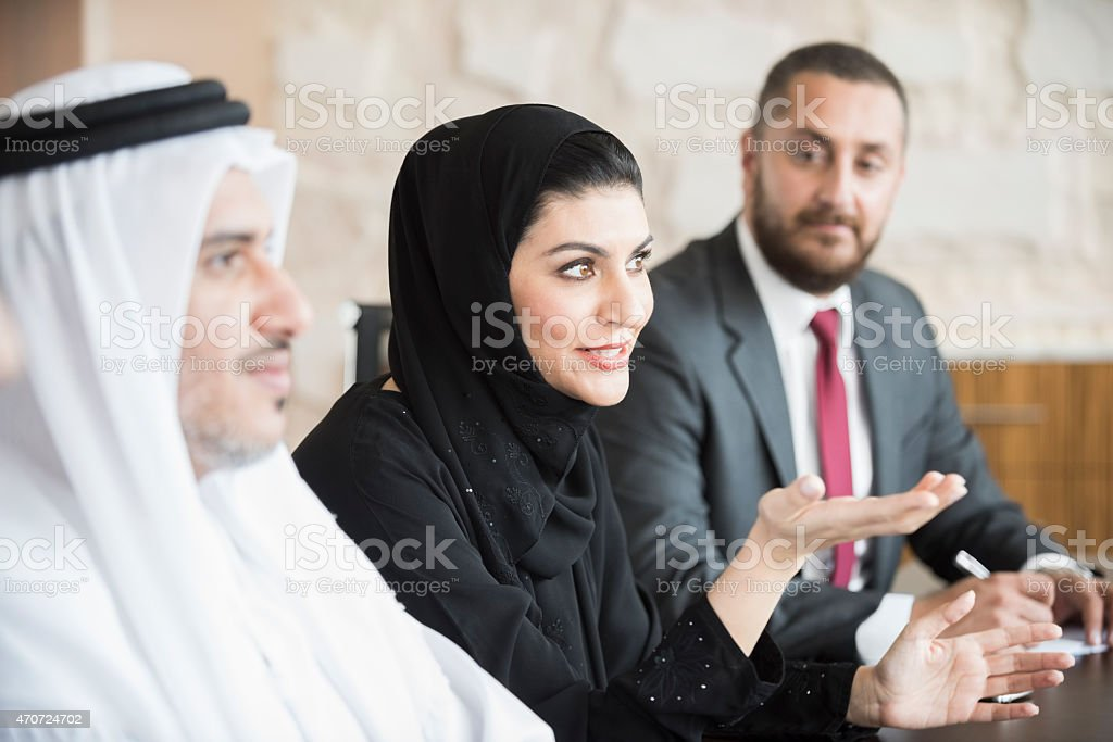 Arab businesswoman in business meeting with colleagues stock photo