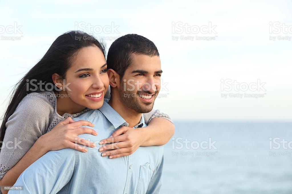 Arab couple flirting in love on the beach stock photo