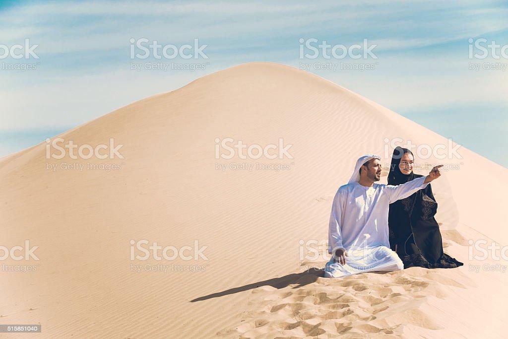 Arab Couple in the desert stock photo