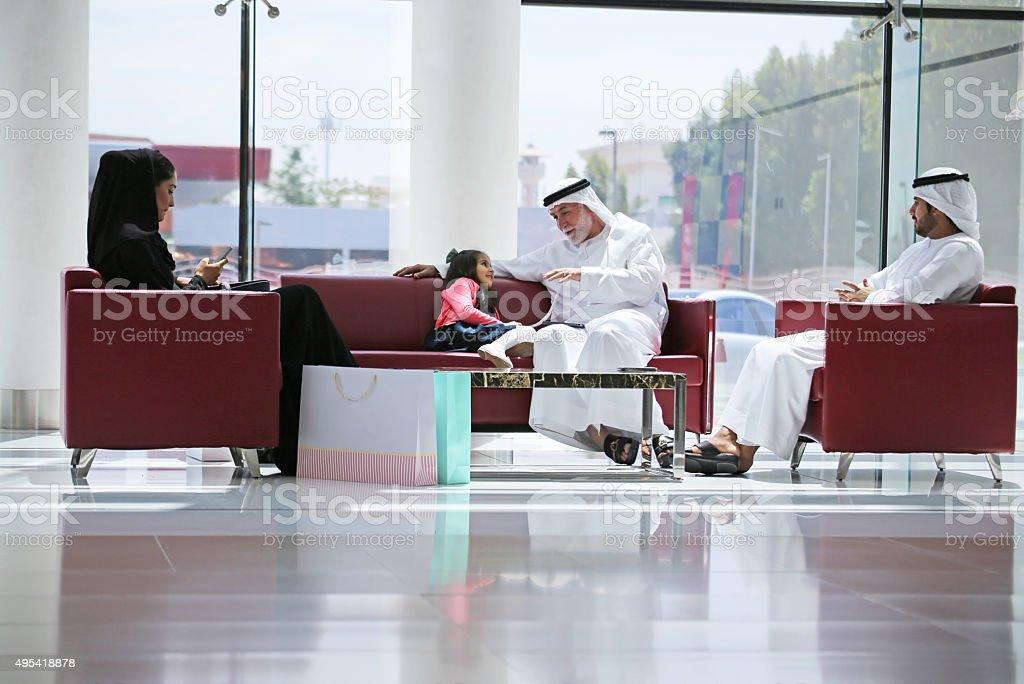 Arab family in shopping center stock photo