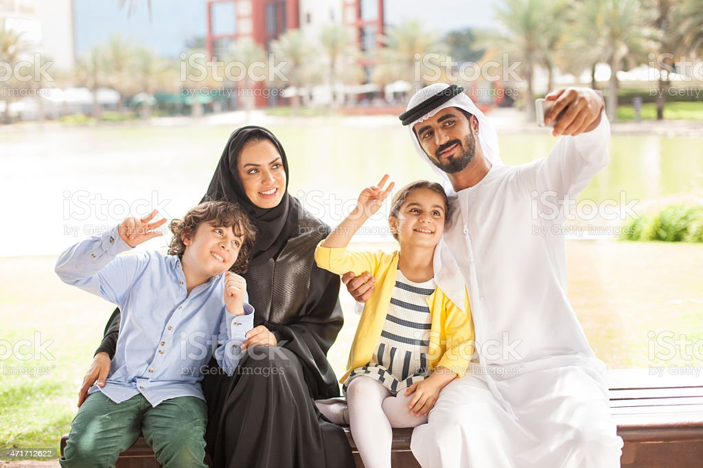 Arab family in the park stock photo