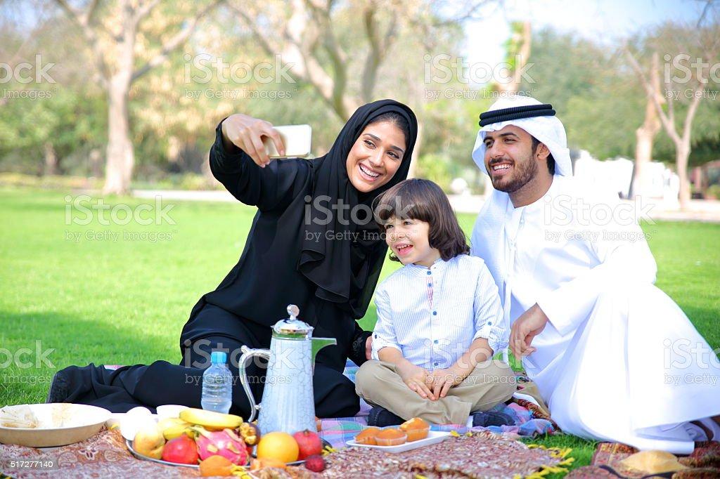 Arab family on picnic outdoors stock photo