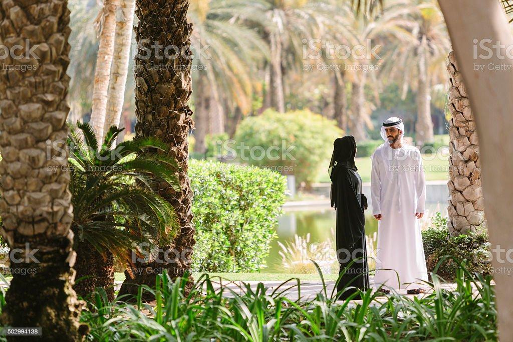 Arab Family Walking in Park stock photo