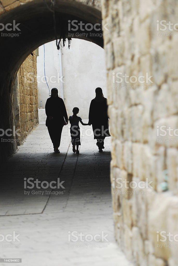 Arab Family Walking the Streets of Acco royalty-free stock photo