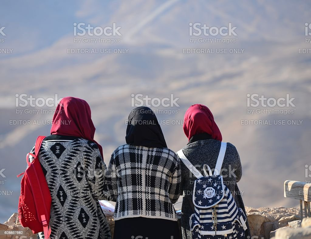 Arab girls are visiting Masada National Park. stock photo
