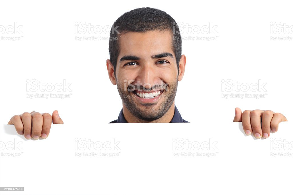 Arab happy man holding a blank banner stock photo