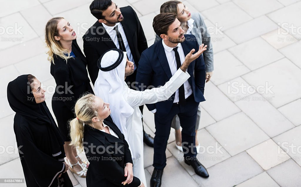 Arab Leader Sharing Project Progress with Business Executives stock photo