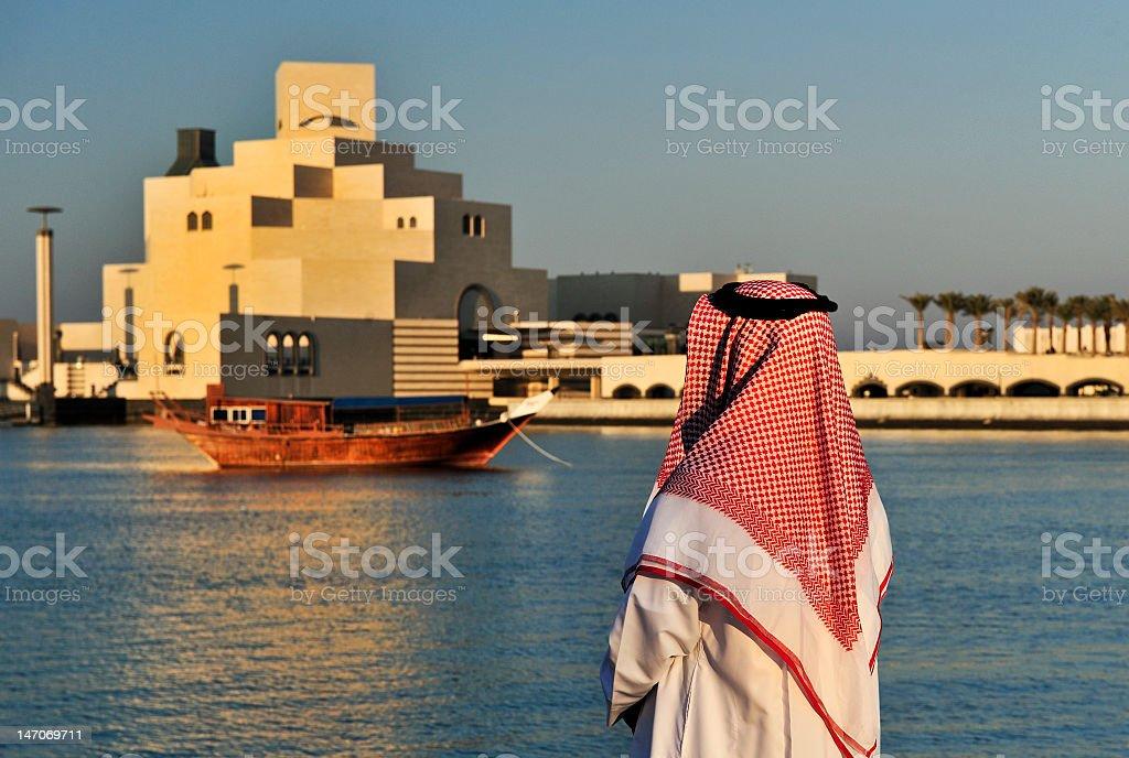 Arab looking over the sea at Doha, Qatar stock photo
