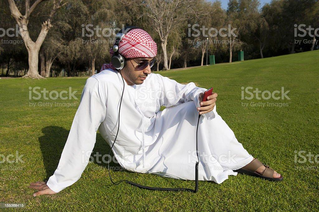 Arab man listening to music royalty-free stock photo