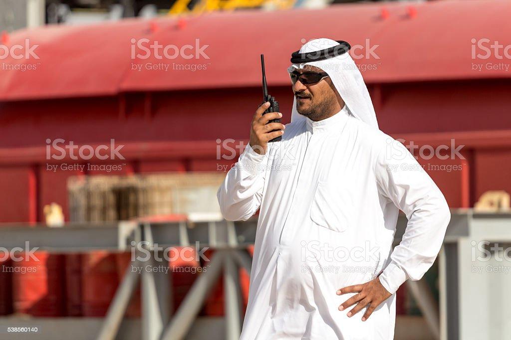 Arab man talking on radio stock photo
