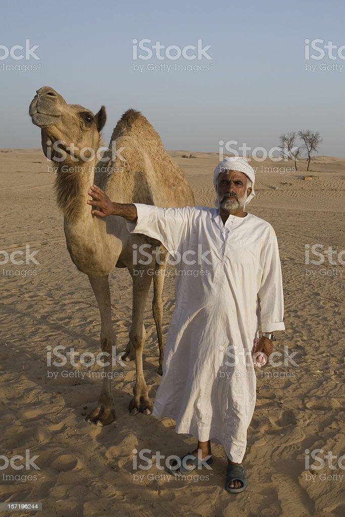 Arab man with camel stock photo