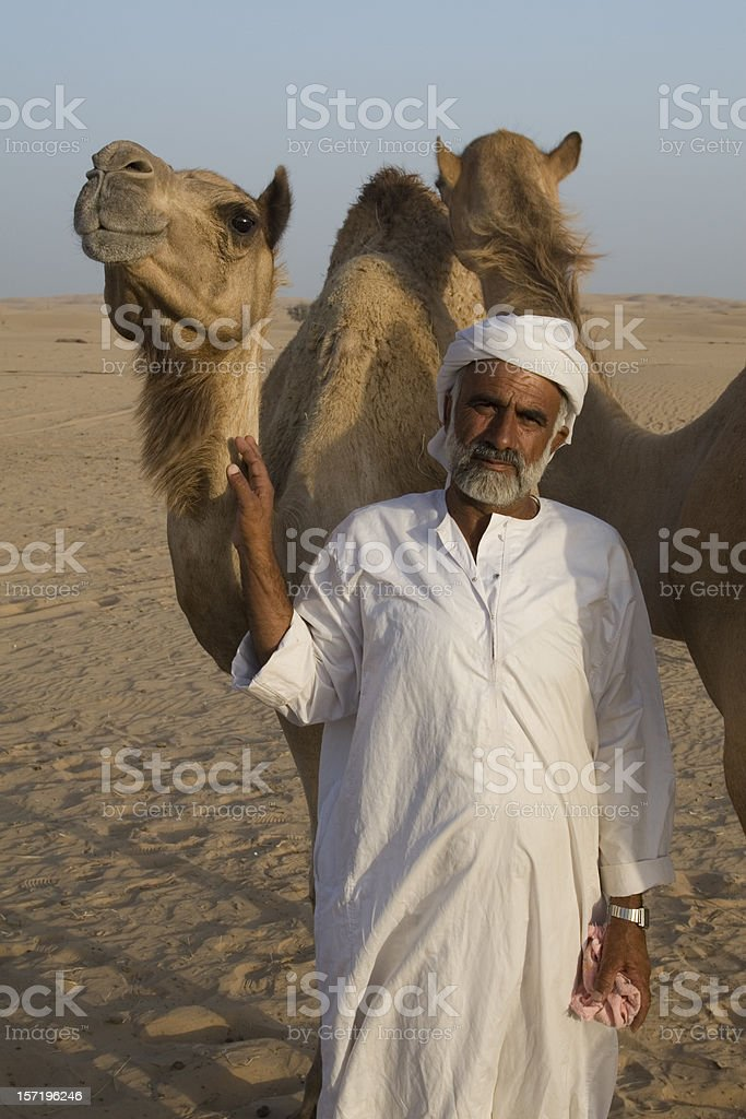 Arab man with camel royalty-free stock photo