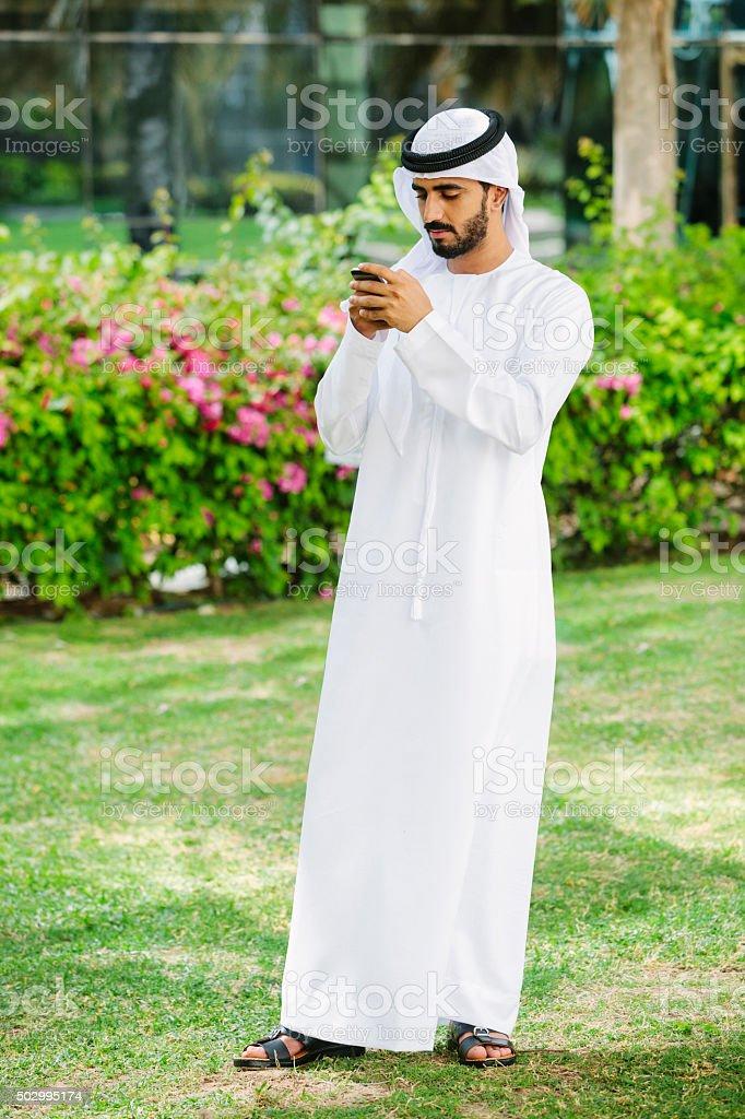 Arab Man with Smartphone stock photo