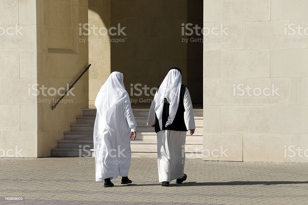 Arab Men in Traditional Clothing stock photo